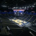 The Memphis Grizzlies and the Minnesota Timberwolves stand for the anthem at an empty Target Center arena for a preseason NBA basketball game Monday,