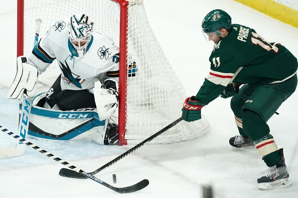 Zach Parise of the Wild looked to score against San Jose Sharks goalie Martin Jones during a game at Xcel Energy Center on Feb. 15.