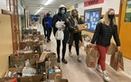 PHOTO BY MARA KLECKER • — High school students from Central High School in St. Paul volunteered at the Ramsey Middle School community pantry on We