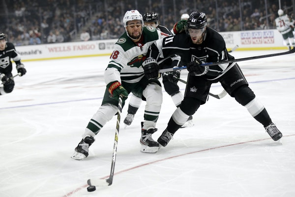 Jordan Greenway of the Wild worked against Anze Kopitar of the Kings during a game in Los Angeles on Nov. 12, 2019.