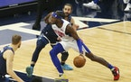 Pistons forward Jerami Grant drove against Timberwolves guard Ricky Rubio during the first quarter Wednesday.