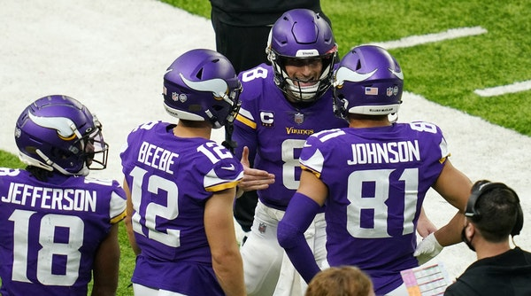 Emotions were running high for several Vikings on Sunday vs. Chicago. Here, quarterback Kirk Cousins had a lively exchange with receiver Bisi Johnson