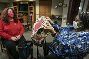 bringing connection and hope: Mary Kay Sobcinski, left, a volunteer with Minneapolis-based Little Brothers-Friends of the Elderly, sat with Fathie Bro