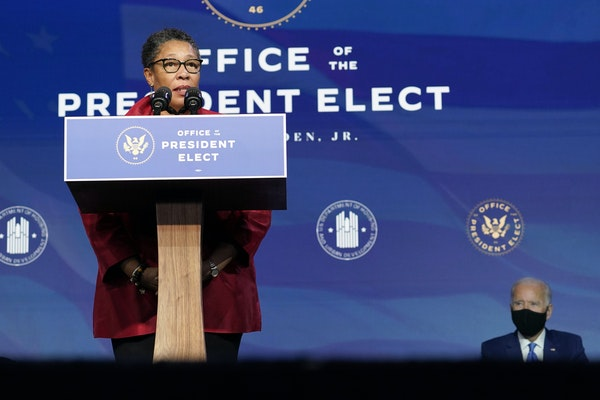 President-elect Joe Biden, right, listens to Rep. Marcia Fudge, D-Ohio, left, his choice to be housing and urban development secretary, during an even