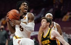 Minnesota guard Marcus Carr drove to the basket vs. Iowa.