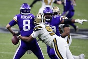 Vikings quarterback Kirk Cousins being sacked by Cameron Jordan.