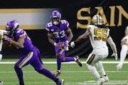 Vikings running back Dalvin Cook ran past Saints linebacker Demario Davis during Friday's game in New Orleans.
