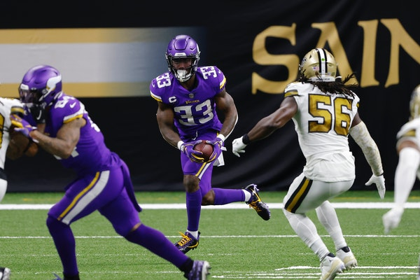 Vikings running back Dalvin Cook ran past Saints linebacker Demario Davis during Friday's game in New Orleans.