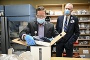 Paul Krogh, director of pharmacy services for North Memorial Health Hospital, unboxed the 975 doses of the Pfizer COVID-19 vaccine that arrived early