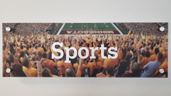 A placard from the Star Tribune Sports department in April 2020. The department has been mostly empty since March as a result of the coronavirus pande