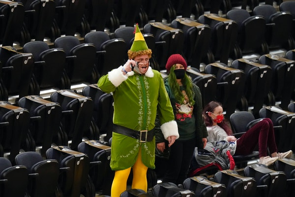 A Jazz fan — Utah is one of six NBA teams allowing fans in for home games — showed his Christmas spirit Saturday night.