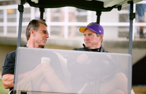 Vikings GM Rick Spielman left talked with head coach Mike Zimmer during NFL camp in 2014.