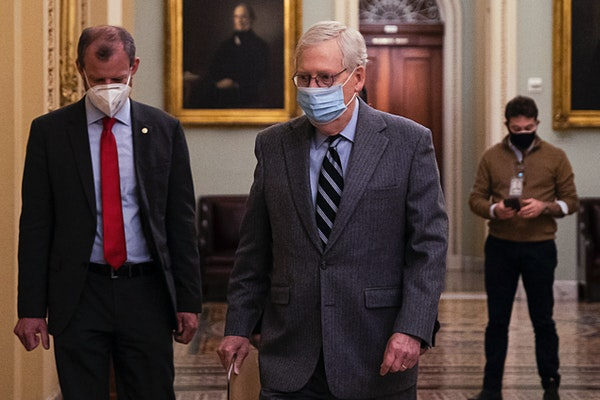 Senate Majority Leader MitchMcConnell(R-KY) walks to open up the Senate floor at the U.S. Capitol on Dec. 16.