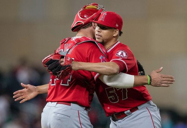 Los Angeles Angels Kevan Smith and Hansel Robles celebrated at the end of an Angels win at Target Field in 2019.