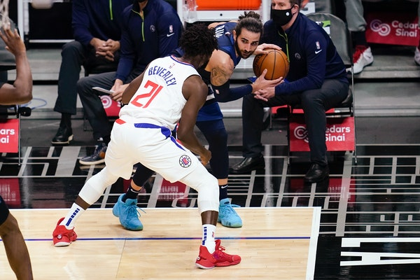 Clippers guard Patrick Beverley, left, defends Timberwolves guard Ricky Rubio in the Wolves' 124-101 loss Tuesday night. (AP Photo/Ashley Landis)