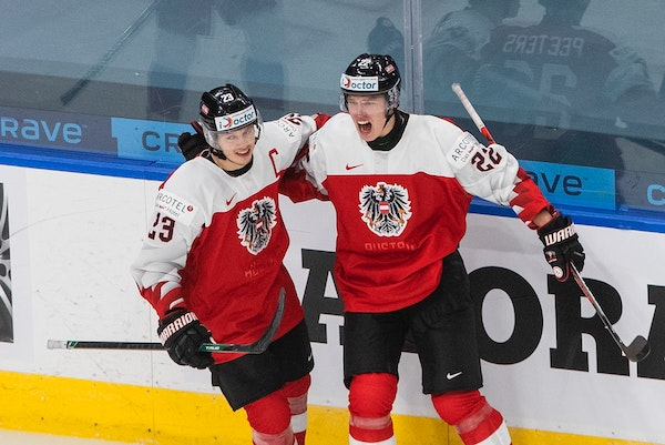 Team captain Marco Rossi (left) celebrated after Senna Peeters (right) scored the Austrians' only goal of the World Junior Championships on Tuesday
