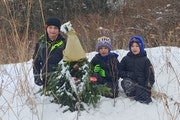 These hunters found the elusive Golden Gnome in a St. Paul park Wednesday. From left: Mason Thorson, 7, and Mack and Mace Peterson, both 5. .