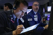 Traders Gregory Rowe and Peter Giacchi worked the floor of the New York Stock Exchange March 12, four days before the Dow Jones fell 12.9%, the second