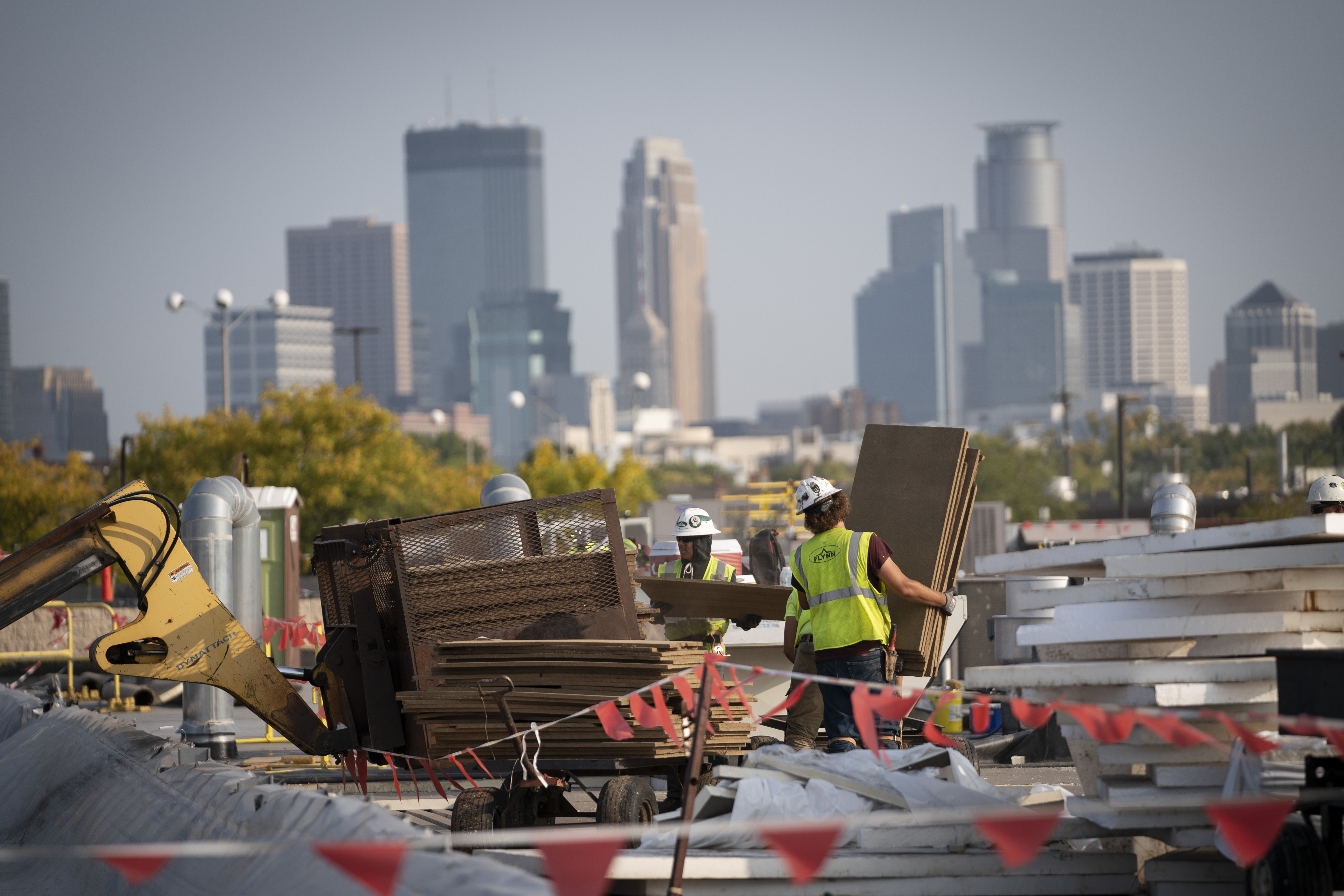 Construction workers worked on the roof of Highland Plaza that has a direct view of the Minneapolis skyline.