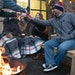 A group of friends toasted a round of complimentary shots around a fire pit at Vikre Distillery's outdoor Wunderbar in Duluth in November. ALEX KORM