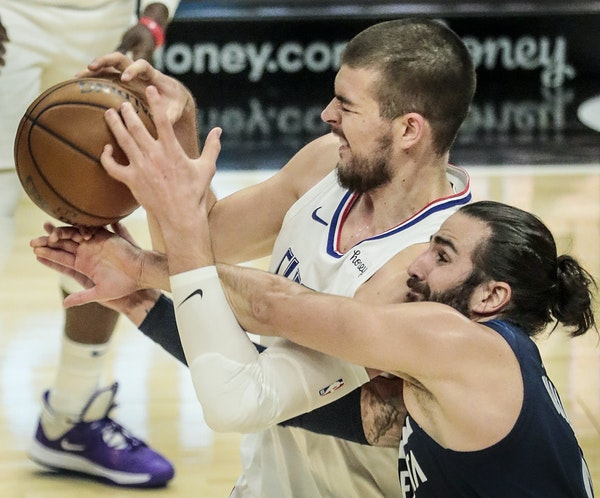 The Clippers' Ivica Zubac (left) was fouled by Timberwolves guard Ricky Rubio during Los Angeles' victory on Tuesday at Staples Center.