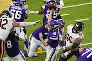 Vikings quarterback Kirk Cousins threw under pressure in the fourth quarter vs. Chicago.