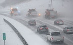 Traffic creeps behind snowplows heading south on I-35W in Minneapolis during an early 2020 snowstorm.