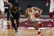 Wisconsin's Jonathan Davis steals the ball from Minnesota's Marcus Carr during the first half Thursday in Madison