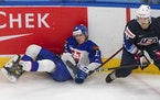 Gophers defenseman Brock Faber of Team USA checked Slovakia's Rayen Petrovicky on Saturday.