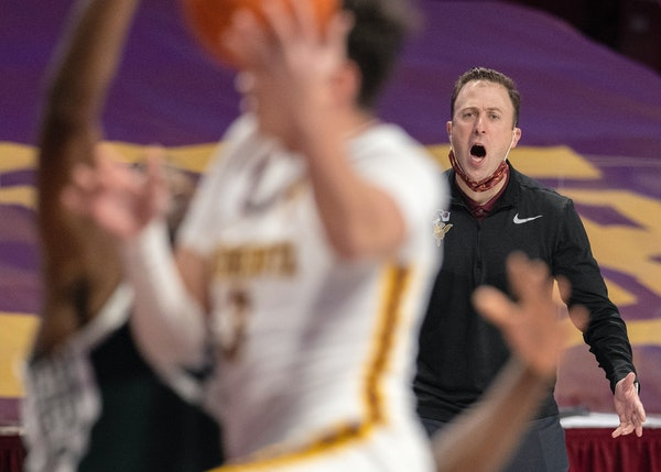Gophers head coach Richard Pitino yelled direction for his team as David Mutaf (3) drove the lane during a game last month.