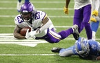Minnesota Vikings running back Mike Boone (23) dives forecextra yard in the second half against the Detroit Lions during an NFL football game, Saturda
