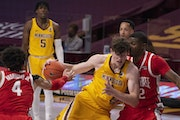 Gophers center Liam Robbins drove hard against the defense of Ohio State forward E.J. Liddell in the first half,