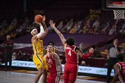 Gophers guard Gabe Kalscheur shot over Ohio State's defense during Sunday's victory at Williams Arena.