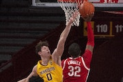 Gophers center Liam Robbins defended the rim against Buckeyes forward E.J. Liddell in the second half Sunday.