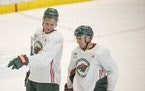 Wild forwards Nick Bjugstad, left, and Zach Parise were on the ice for the team's first day of practice at Tria Rink in St. Paul on Monday.