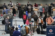 Holiday travelers crowd the ticketing area of terminal one Wednesday at MSP in Minneapolis. Travel experts were predicting Wednesday to be the busiest