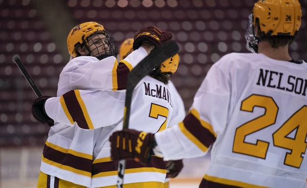 Minnesota Gophers left wing Jonny Sorenson (11), left, celebrated his first period goal with teammate and right wing Brannon McManus (7).