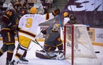 Sammy Walker celebrated after Brannon McManus boosted the Gophers' lead over Arizona State to 5-3 in the third period Monday.