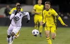 Wil Trapp, right, played for Columbus against the Loons and forward Abu Danladi (99) on Oct. 28, 2018.