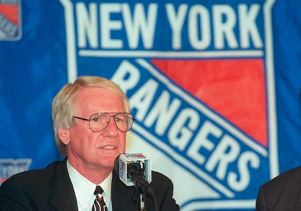 FILE - In this Feb. 19, 1998, file photo, John Muckler speaks at a news conference after he was named new head coach of the New York Rangers hockey te