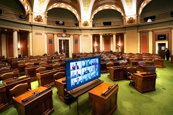 In an almost empty House Chamber, most legislators were sworn in remotely in groups of nine at a time, via Zoom at the Minnesota State Capitol. A few