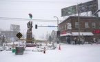 Snow fell and strong winds blew on George Floyd Square at 38th and Chicago Ave. S. Wednesday in Minneapolis.    ]DAVID JOLES • david.joles@startribu