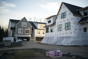Exterior of the completed model home and another one under construction in Eden Prairie. (Staff photo by  JEFF WHEELER/ jeff.wheeler@startribune.com)