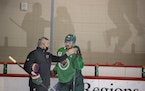 Marcus Johansson got instruction from assistant coach Bob Woods at the Wild's first practice on Monday.