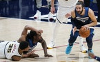 Timberwolves guard Ricky Rubio, right, picked up a loose ball after Nuggets guard PJ Dozier, left front, lost control while tangling with Wolves cente