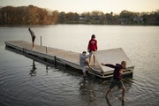 Jackson Arndt, Will Rehfuss, Ryan Becker and his brother, Nick, front to back, got back on shore after goofing off on the dock in Silver Lake while at
