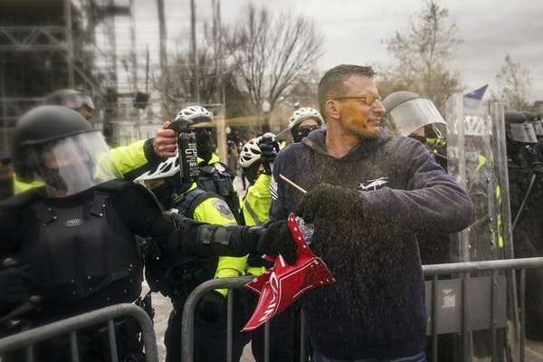 Trump supporters try to break through a police barrier, Wednesday, Jan. 6, 2021, at the Capitol in Washington. As Congress prepares to affirm Presiden