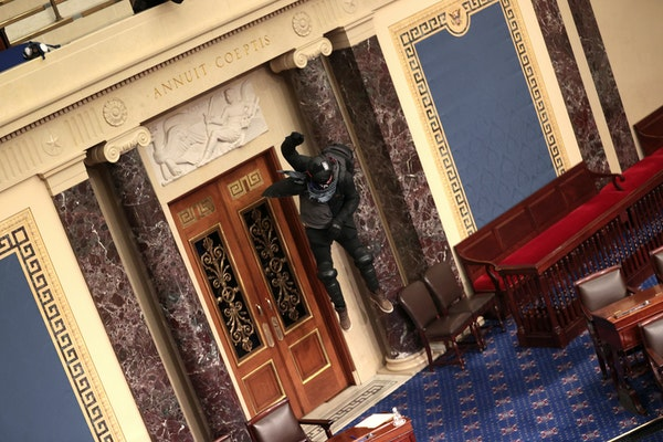 Protesters enter the Senate Chamber on Wednesday, Jan. 6, 2021 in Washington, D.C. Congress held a joint session today to ratify President-elect Joe B