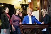 Abuse survivors Laura Stearns and Jina Penn-Tracy, center, were at a 2019 news conference with attorneys Molly Burke, left, and Jeff Anderson and CTC�
