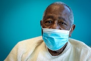 Hall of Famer Hank Aaron sat for a portrait after receiving his COVID-19 vaccination on Tuesday at the Morehouse School of Medicine in Atlanta. Aaron